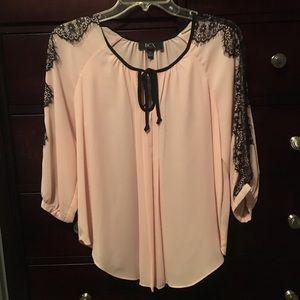 Light pink and black lace blouse